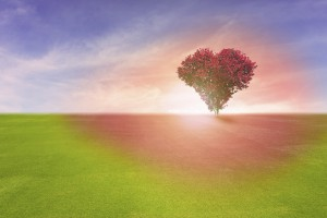 Power of love, red color tree in heart shape symbol, representing romantic love spreading red color to grass field and blue sky, Valentine's Day holiday concept.