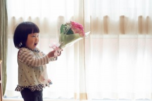 2-year old Japanese Baby Girl With Carnation Flower on Mother's Day.